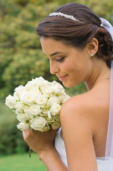 bride with white wedding gown and floral bouquet 2